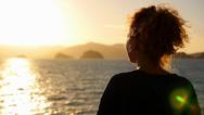 Stock Video Footage of Dreamy Woman Enjoying Amazing Seascape during Sunrise.