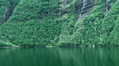 Europe Norway Geirangerfjord 001 forest and waterfall on a slope Stock Footage