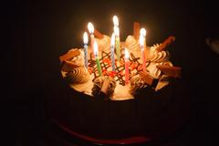 Birthday cake with candle light Stock Photos
