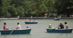 4K - People rowing boats on the boating lake at Retiro Park, Madrid, Spain - stock footage
