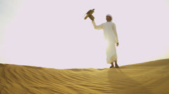 Tethered Bird Prey Arab Falconers Wrist Desert Sunset - stock footage