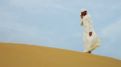 Young Arab Male Desert Location Smart Phone Stock Footage