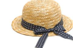 Feminine women's straw hat with the ribbon Stock Photos