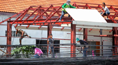 THAILAND, KOH SAMUI, JULY 2, 2014: Construction crew working on the roof Stock Footage
