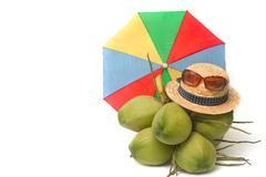 Straw hat and sunglass with young coconut Stock Photos