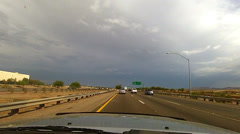 Driving dash cam freeway storm front east bound Arizona Stock Footage