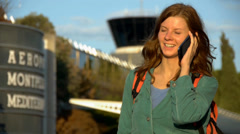 HD1080p50 Young Woman Tourist With Backpack at the Airport with smart phone Stock Footage