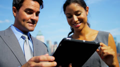 Diverse business team closing contract handshake on tablet overlooking Manhattan - stock footage