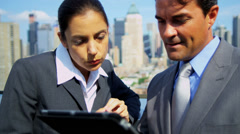 Teamwork of diverse colleagues investing online on touch screen - stock footage