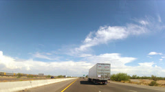 Dash cam time lapse desert freeway travel traffic big rigs train -1 Stock Footage