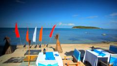 Beach restaurant with a beautiful sea view and waving flags. Thailand Koh Samui, - stock footage