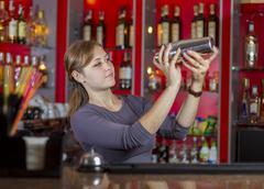 Bartender girl behind the counter Kuvituskuvat
