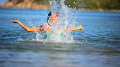Cheerful brunette young woman in the sea water splashes. Koh Samui Thailand Stock Footage