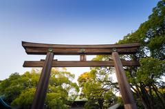 Torii gate standing at the entrance to meiji jingu shrine, tokyo, japan. Stock Photos