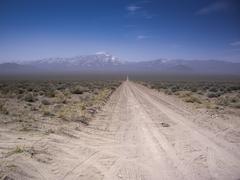 Desert vista on dirt road Kuvituskuvat
