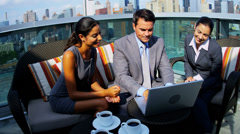 Multi ethnic management focusing on commodity market on laptop Stock Footage