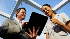 Team of diverse  managers working on touch screen technology - stock footage