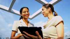Diverse business managers working internet online on rooftop - stock footage