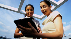 Multi ethnic businesswomen focusing online investment banking on rooftop - stock footage