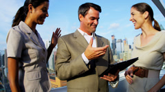 Handshake of diverse business colleagues analyzing finance on touch screen Stock Footage