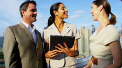 Business success on diverse managers using tablet ending handshake - stock footage