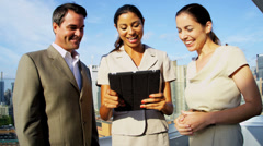 Multi ethnic managers discussing financial markets with IT technology outdoor Stock Footage