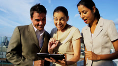 Triumph of multi ethnic business managers making profit on market using tablet - stock footage