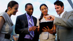 Multi ethnic successful managers working on portfolio online on rooftop - stock footage