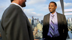 Handshake of multi ethnic business team closing contract overlooking Manhattan - stock footage