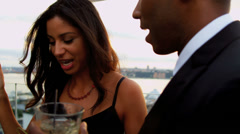 Sunset cocktail party of diverse woman and man smiling and drinking Stock Footage