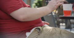 Overweight Man Sitting in Park Stock Footage