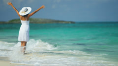 Girl in White Celebrating on Tropical Beach Stock Footage