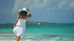 Pretty Girl White Dress Splashing Ocean - stock footage