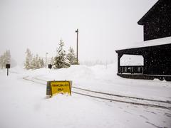 snowcoaches only sign in snowstorm yellowstone - stock photo