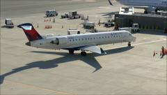 Delta Airlines arrives at Terminal Stock Footage