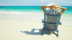 Young Female Sun Hat Relaxing Beach Chair Stock Footage