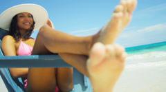 Young Hispanic Girl Sun Hat Relaxing Beach Chair - stock footage