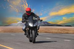 Young man riding motorcycle in asphalt road curve use for extreme sport leisu Stock Photos
