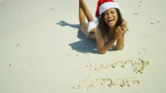 Smiling Girl Relaxing Island Beach Wearing Xmas Hat Stock Footage