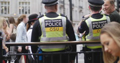 Pedestrians pass transport police in London 4K Stock Footage