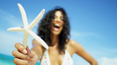Portrait Smiling Hispanic Girl Holding Star Fish Fun Outdoors Stock Footage