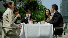 Successful Multi Ethnic Bankers Coffee Downtown Office Rooftop - stock footage