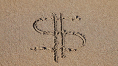 Sign 'Dollar' Washed Away on the Beach Stock Footage