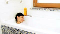Beautiful woman relaxing taking a boath at home Stock Footage