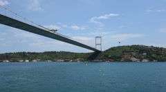 Passing under the Fatih Sultan Mehmet Bridge in Istanbul Turkey Stock Footage