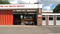 Fire Engine Driving into  Fire Station Stock Footage