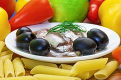 Anchovy fillets with macaroni olives and vegetables Stock Photos