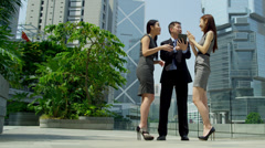 Asian Chinese Business Team Tablet News Success Stock Footage