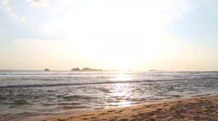 Ocean view in Hikkaduwa in sunset with waves splashing the beach. Stock Footage