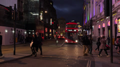 Great evening shot of Shaftesbury Avenue in London with London Red Bus Stock Footage
